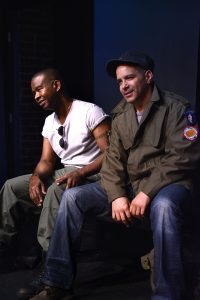 "Tony Williams, Mark Adair Rios in the play ""Raw Open Wound,"" one of the three plays in ""A 60's Trilogy"" written by Tommy Carter, directed by David Fofi. Produced by USVAA Veterans Repertory.  Photo by Joel Daavid"